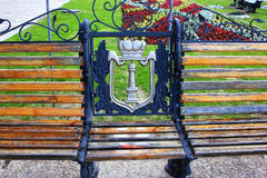 Part of the bench in the park, against the background. Of the flower bed Royalty Free Stock Images