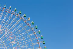 Part of big funfair ferris wheel with clear blue sky Stock Image