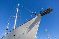 Part of big white ship moored in port. Port in Jastarnia, Poland Royalty Free Stock Image