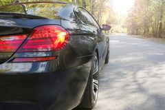 Part of the black car on the background of the road royalty free stock image