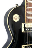 Part of black color electric guitar Royalty Free Stock Image