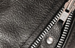 Part black leather clothing with a zipper. macro Stock Photos