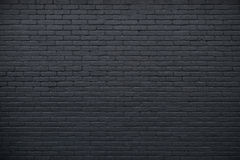Part of black painted brick wall Royalty Free Stock Photography