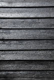 Part of black wooden fence or part of barn Royalty Free Stock Photos
