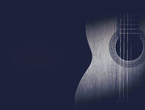 Part of a blue acoustic guitar on black background. Royalty Free Stock Photography