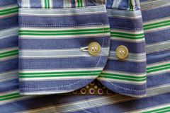 Part of blue striped shirt with green lines texture or background Royalty Free Stock Photography