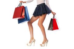 Part body, beautiful female slender legs. girl holding a pa Royalty Free Stock Image