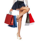 Part body, beautiful female slender legs. Sexy girl holding a pa Stock Photo