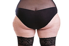 Part of the body behind the girl with cellulite Stock Image