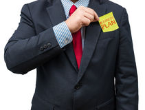 Part of body of business man who takes out Yellow notepad from t Royalty Free Stock Image