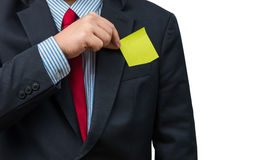 Part of body of business man who takes out Yellow notepad from t Royalty Free Stock Photos