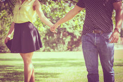 Part body of couple in park Stock Photo