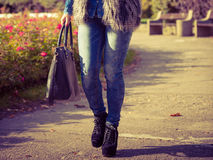 Part body of fashionable woman. Autumnal fashion of women. Fashionable girl wearing trendy clothes walking in park. Part body of model outdoors Stock Photography