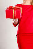 Part body lady with red gift. Stock Photo