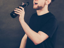 Part body man addicted to alcohol. Stock Photos