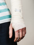 Part body man with bandaged hand. Stock Images