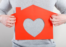 Part body man with heart house. Stock Photography