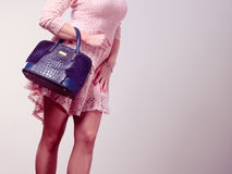 Part body woman in dress with bag. Stock Images