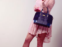 Part body woman in dress with bag. Royalty Free Stock Photo