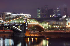 Part of Bogdan Khmelnitsky bridge near Kievsky railway station. And view of business complex Moscow-City at night in Moscow, Russia Stock Images