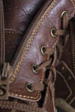 Part of a boot. Part of a leather brown boot with zipper Royalty Free Stock Photography