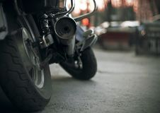 Part of a brand-new motorcycle with wheels and a dirty exhaust pipe stock photography