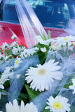 Part of bridal bouquet. On the red car Royalty Free Stock Photo