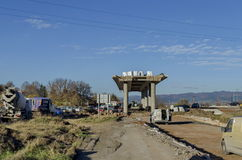 Part from bridge above new construction of road with rows of cars Stock Photo