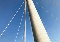 Part of the bridge building and blue sky. Part of the bridge building and the blue sky from bottom angle Stock Image