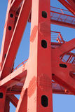 Part of bridge frame closeup. Red part of bridge frame on blue vertical closeup royalty free stock photo
