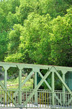 Part of bridge in steel structure and green around Stock Photo
