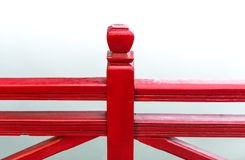 Detail of wooden red bridge with water background. Stock Photography