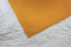 Part of brown envelope. On paper texture Royalty Free Stock Images