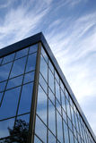 Part a building. Part modern a building on a background of the sky Royalty Free Stock Images