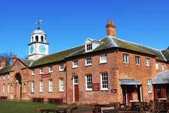 Part of buildings and clock tower in Clumber park Royalty Free Stock Photos
