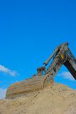 Part of a bulldozer sticking in the sand Stock Image