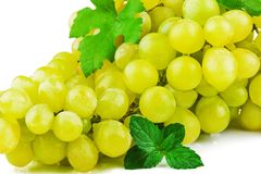 Part of bunch of grapes with green leaf. Isolated on white background Stock Photos