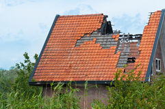 Part of a burnt house. Between growing weeds Royalty Free Stock Images