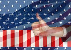 Part of business man with thumb up against american flag. Digital composite of Part of business man with thumb up against american flag Royalty Free Stock Photo