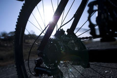 Part of Bycicle and a sunrise in dirty enviroment Stock Photo