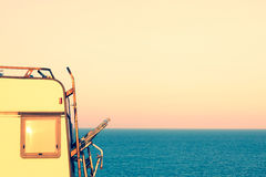 Part of camper on the seashore at sunset Royalty Free Stock Photo