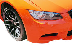 Part  car. Part of the car of orange color Royalty Free Stock Images