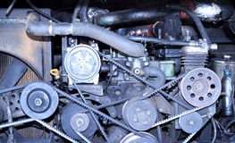 Part of car engine. Pulleys with belt in the car motor stock photos