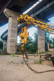 Part of the cargo crane with hook Stock Photos