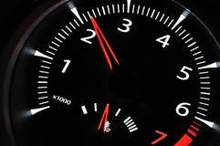 Part of cars dashboard. Illuminated tachometer closeup. Black background Royalty Free Stock Image