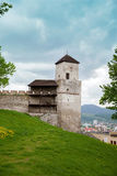 The part of castle's wall with turret clock in Trencin Stock Photos