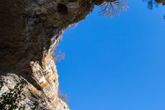 Part of the cave and vibrant blue sky in Prohodna Royalty Free Stock Photos