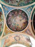 Part of the ceiling in the church. Antique painting. Religion. Ceiling painting on a religious theme. Part of the image in the temple stock image