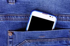 Part of cellphone in blue jeans pocket Stock Images