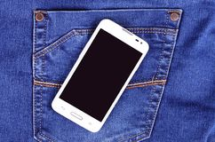 Part of cellphone on blue jeans pocket Royalty Free Stock Photo